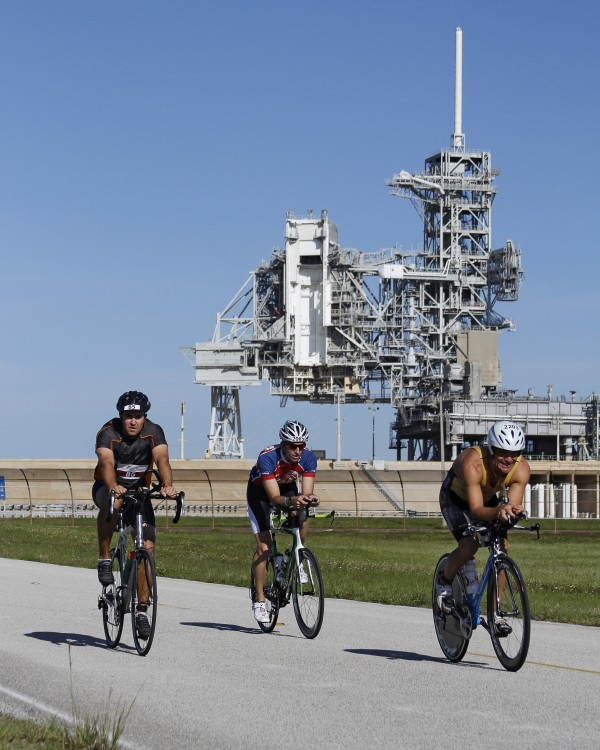 Athletes riding past launch pad 39-A